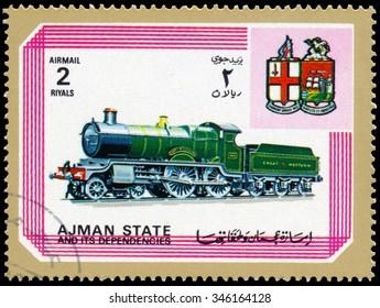 AJMAN - CIRCA 1972: a stamp printed in Ajman shows locomotive and crest