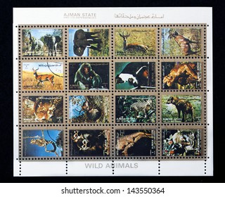 AJMAN- CIRCA 1973: A collection of sixteen stamps showing pictures of endangered wild animals, circa 1973