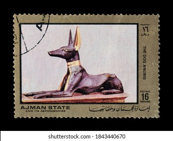 AJMAN STATE - CIRCA 1972 : Cancelled postage stamp printed by Ajman state, that shows The dog Anubis from ancient Egypt, circa 1972.