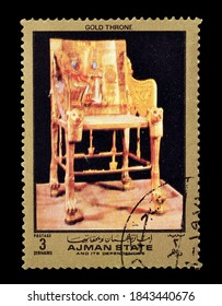 AJMAN STATE - CIRCA 1972 : Cancelled postage stamp printed by Ajman state, that shows Gold throne from ancient Egypt, circa 1972.