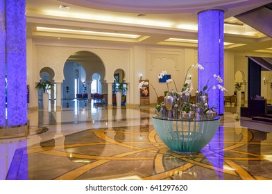 Ajman. Summer 2016. Bright and modern interior The Ajman Palace Hotel. Marble floors in the interior. Columns and bright decor. Bouquets of flowers in the interior.