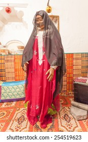 AJMAN, UAE - DEC 17: Bedouin woman in traditional dress in the museum of Ajman. December 17, 2014 in Ajaman, United Arab Emirates