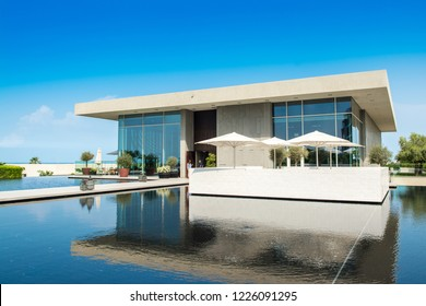 Ajman, United Arab Emirates - 30 October 2018: Landscape with modern design buildings, lagoon pool and garden in a luxury hotel in Al Zorah coastline