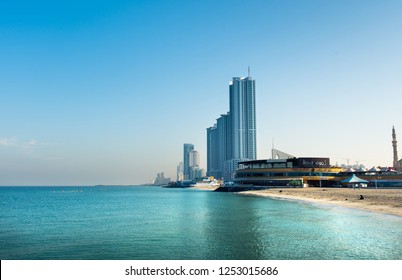 Ajman, United Arab Emirates - December 6, 2018: Ajman Corniche Beach beautiful coast in the city downtown area surrounded by high residential buildings