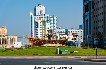 Ajman, United Arab Emirates - December 6, 2018: Yacht monument roundabout on Ajman Corniche road by the seaside on a sunny day