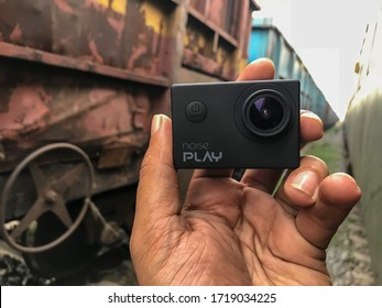 Ajmer, Daurai / India- July 26, 2018 : The Noise play action camera is held in the hand from outside the train.