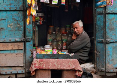 AJMER, INDIA - FEB 04: An unidentified retail shop owner look for customers on February 04,2015 in Ajmer, Rajasthan, India.Small retail shops face big threat from the modern retailers chains in India.