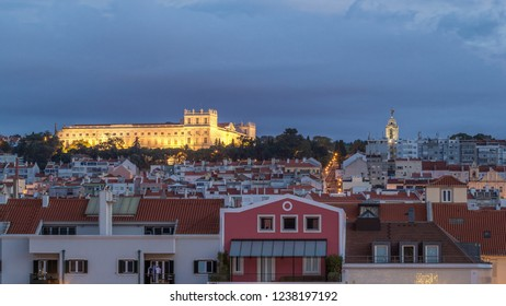 The Ajuda National Palace is a neoclassical monument in the civil parish of Ajuda night to day transition timelapse in Lisbon, Portugal. View from Belem waterfront