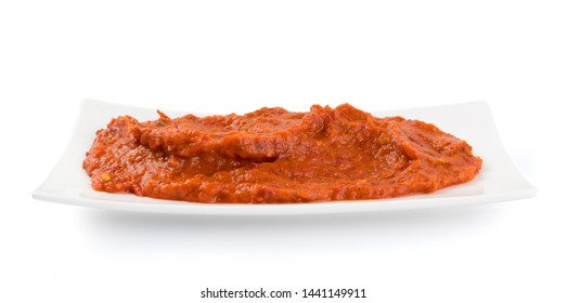 Ajvar or pindjur orange vegetable spread made from bell peppers, eggplants and oil. Marinara sauce, salsa, chutney or lutenica isolated