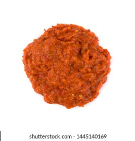 Ajvar or pindjur orange vegetable spread made from bell peppers, eggplants and oil. Marinara sauce, salsa, chutney or lutenica top view isolated