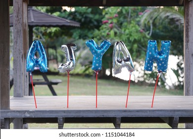 AJYAN words hanging in the garden