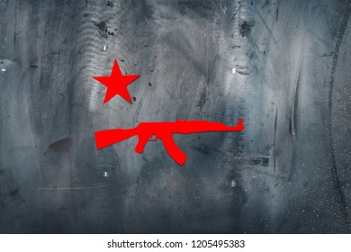 AK 47. Red paper Soviet star and Kalashnikov automatic rifle, on metal grunge background. Copy space.