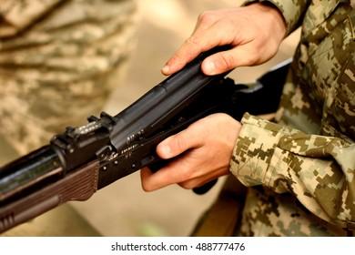 AK-47 Kalashnikov Russian automatic gun rifle USSR in soldiers hands