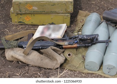 AK-47 near the artillery shells