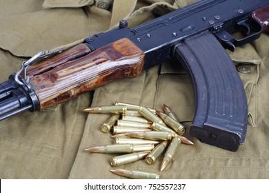 AK47 on khaki uniform background