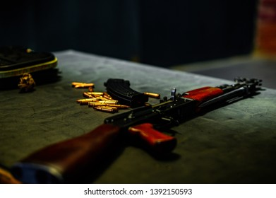 AK47 rifle gun on a table in a shooting range with bullets, ammo