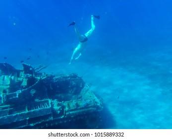 Akaba, Jordan - December 25, 2017: Swimmer under clear blue water while snorkeling