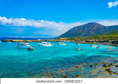 AKAMAS, CYPRUS, AUGUST 19, 2017:Tourist boats are mooring at Blue lagoon at Akamas peninsula on Cyprus
