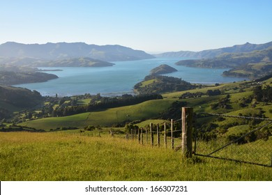 Akaroa Harbour viewed from the Summit Road at Dawn, New Zealand