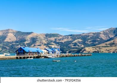 Akaroa,New Zealand - May 12,2016 : Jetty pier of Akaroa, south island of New Zealand. People can seen exploring around it.