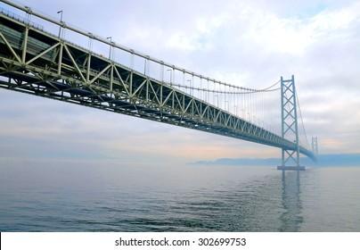 Akashi Kaikyo Bridge, also known as the Pearl Bridge, links the city of Kobe on the mainland of Honshu to Iwaya on Awaji Island, in Japan