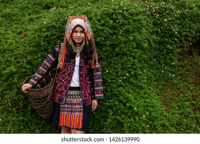 Akha hill tribe women, Akha women stand with green plants background, Chiang Rai, northern Thailand.