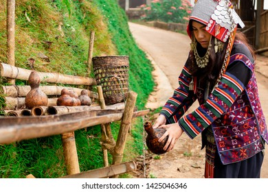 Akha hilltribe women, Akha women, collect water in water bottle in the morning,  Pha HI Village, Chiang Rai, northern Thailand.