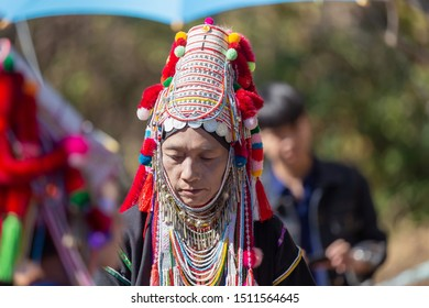 Akha tribe,Portrait of woman in traditional clothes and silver jewelery, Akha in hill tribe dress at north of Thailand , Phrae, December 27, 2018.