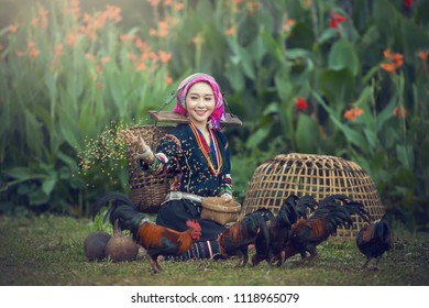 Akha women in rural Asia are happy with the chicken feed.