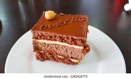 Akhaltsikhe, Georgia - August, 2018. Chocolate cake with hazelnuts
