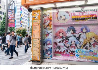Akihabara, Japan - July 15, 2019: People walk past an anime themed store in Akihabara.