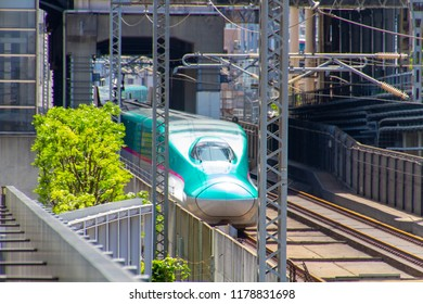 AKIHABARA, TOKYO, JAPAN - APRIL 26, 2018. The Tsuka Express train in the popular tourist district known as 'Akiba' or 'Electric Town' in central Tokyo.
