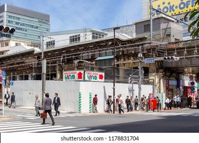 AKIHABARA, TOKYO, JAPAN - APRIL 26, 2018. People walk by construction next to Akihabara Station in the popular tourist district known as 'Akiba' or 'Electric Town' in central Tokyo.