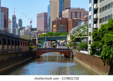 AKIHABARA, TOKYO, JAPAN - APRIL 26, 2018. A view of the Kanda River from the Manseibashi Bridge in the popular tourist district known as 'Akiba' or 'Electric Town' in central Tokyo.