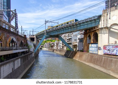 AKIHABARA, TOKYO, JAPAN - APRIL 26, 2018. A railway bridge over the Kanda River in the popular tourist district known as 'Akiba' or 'Electric Town' in central Tokyo.
