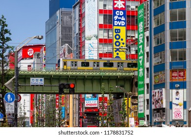 AKIHABARA, TOKYO, JAPAN - APRIL 26, 2018. The steel train bridge passes through the popular tourist district known as 'Akiba' or 'Electric Town' in central Tokyo.