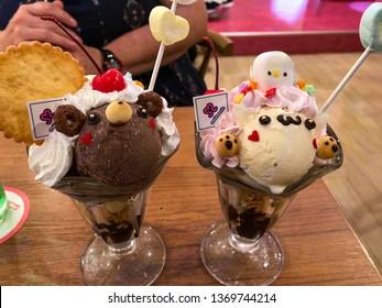Akihabara, Tokyo / Japan - September 20 2018: Photo of Maidreamin maid cafe desserts, one chocolate, one vanilla.