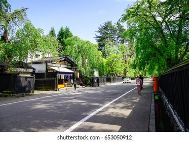 Akita, Japan - Mar 17, 2017. People on rural road at Kakunodate Samurai District. Kakunodate is a former castle town and samurai stronghold in Akita Prefecture.