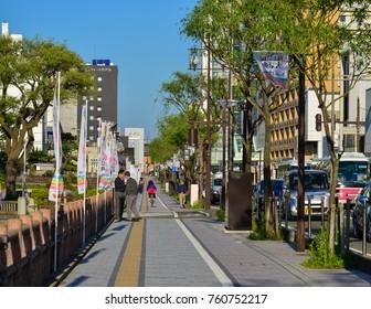 Akita, Japan - May 17, 2017. People walk on street at downtown in Akita, Japan. Akita is a large prefecture at the Sea of Japan coast in the northern Tohoku Region.