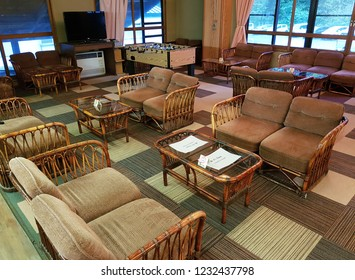 Akita, JP - SEPTEMBER 26, 2018: Interior of Japanese culture traditional living room in Ryokan (Japanese style hotel) that have many chairs and tables with TV and games for tourists relaxation.