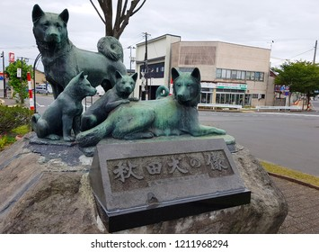 Akita, JP - SEPTEMBER 27, 2018: The copper statue of Akita dog family that standing in front of JR Akita Railway Station, as the most famous symbol landmark of Akita City.