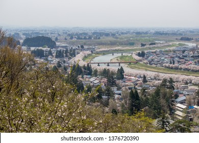 Akita,Tohoku,Japan on April 27,2018:Panoramic view of Kakunodate town and the Hinokinaigawa River during cherry blossom festival as seen from the former site of Kakunodate Castle on the hilltop.