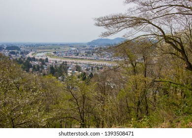 Akita,Tohoku,Japan:Panoramic view of Kakunodate town and the Hinokinaigawa River during cherry blossom festival as seen from the former site of Kakunodate Castle on the hilltop.