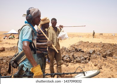 Akjoujt, Mauritania - September 8, 2016: artisanal miners looking for gold nuggets with metal detectors in the Mauritanian desert. 2016 was the start of a gold rush frenzy in Mauritania.