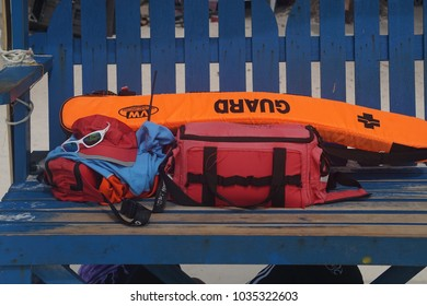 Aklan, Philippines; February 8, 2018: A lifeguard's gear: First aid kit, floatation device, walkie-talkie, a ball cap and sunglasses, all found on an observation chair in the Boracay Island beach.