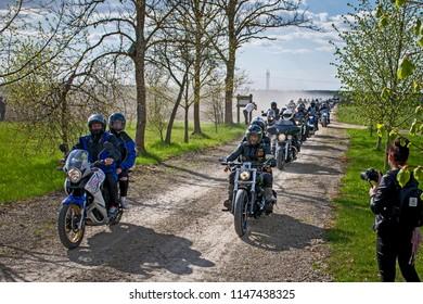 Akmene District Municipality, Lithuania. May 5, 2018 Biker season opening. Lithuanian biker clubs run on a dusty rural road.