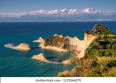 Akra Drastis,  Rock islands jutting out of the ocean along a shoreline