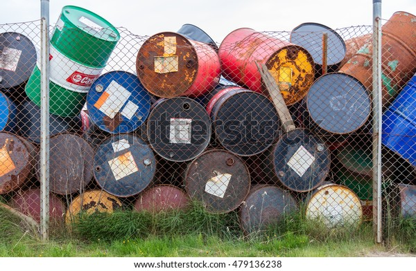 AKRANES, ICELAND - AUGUST 1, 2016: Oil barrels or chemical drums stacked up for cargo on August 1, 2016.