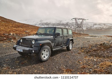 AKRANES, ICELAND - MAY 07, 2018: Jeep Wrangler Unlimited four wheel drive vehicle on a path in the hills for electric line maintenance