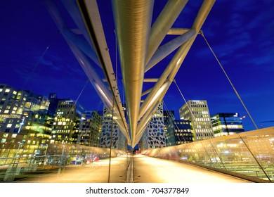 Akrobaten pedestrian bridge at dusk in Oslo, Norway